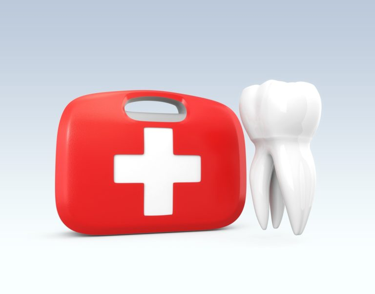 A red first aid kit with a white tooth beside it