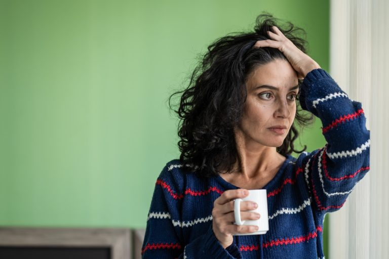 Image showing stressed woman holding a coffee mug