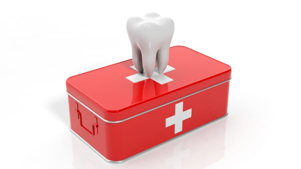 tooth on top of a red first aid kit